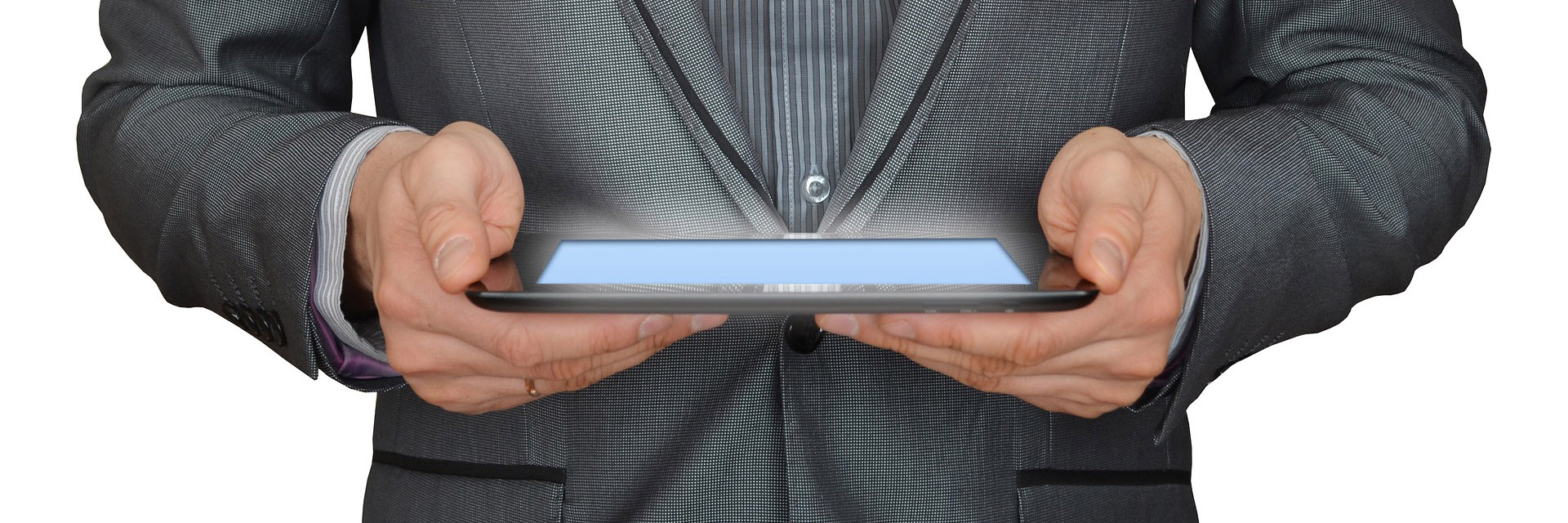 Man in Suit Holding Tablet